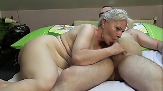 BEDROOM SEX BY MATURE COUPLE..