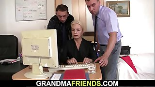 Old blonde woman sucks two..
