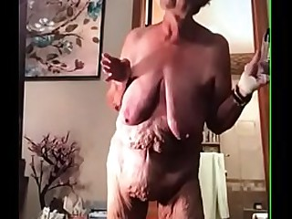 Saggy granny uses a egg sex..