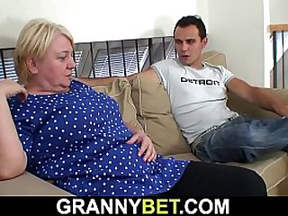 Busty granny pleases him