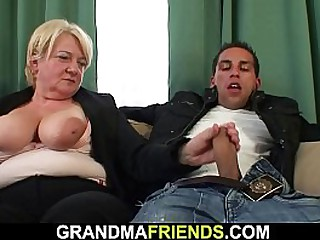 Busty granny takes two cocks..